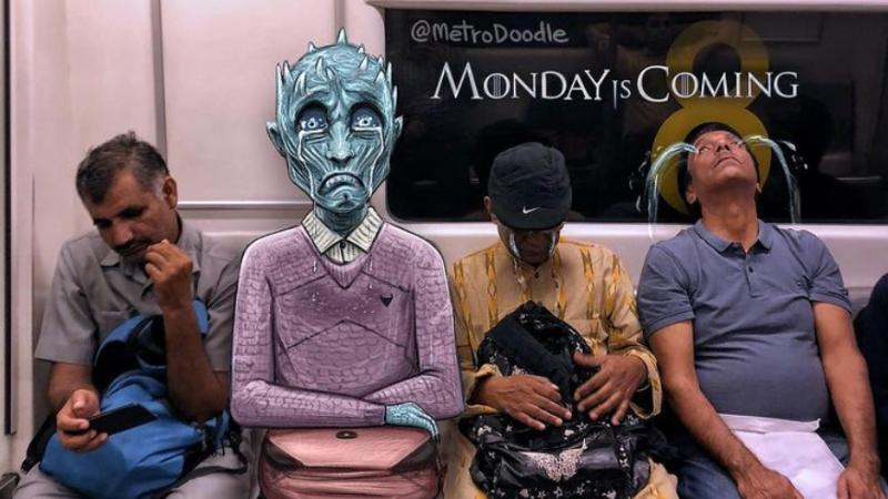 """A monster joins in on the """"monday blues"""" gloom of metro passengers (Photo: Samar Khan)"""